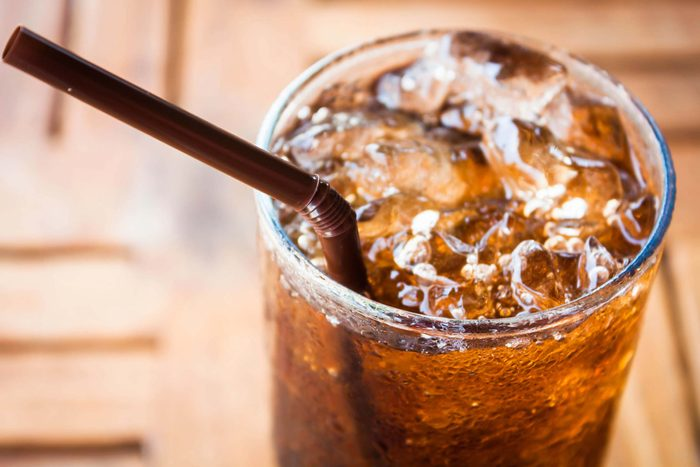 Glass of soda with ice and straw
