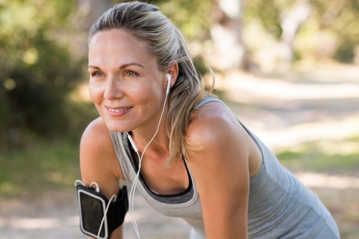 woman listening to music during an outdoor workout
