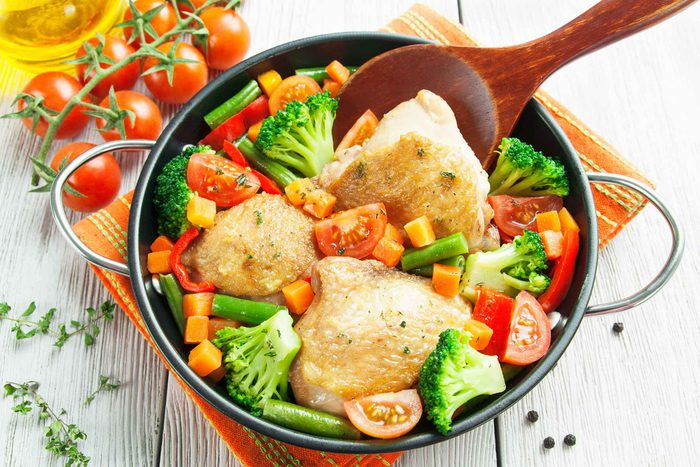 Chicken with broccoli, carrots and tomatoes in a casserole dish