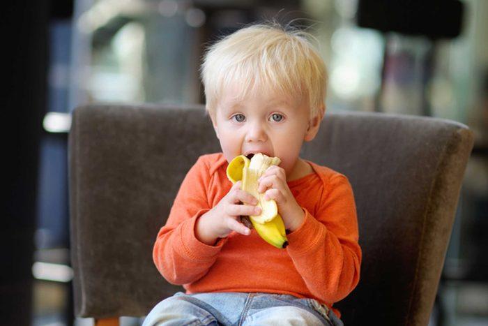 toddler eating a banana