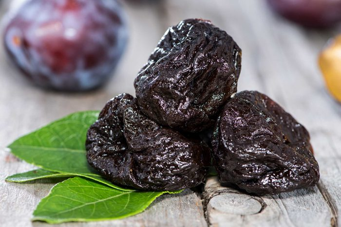 three prunes in front of a plum