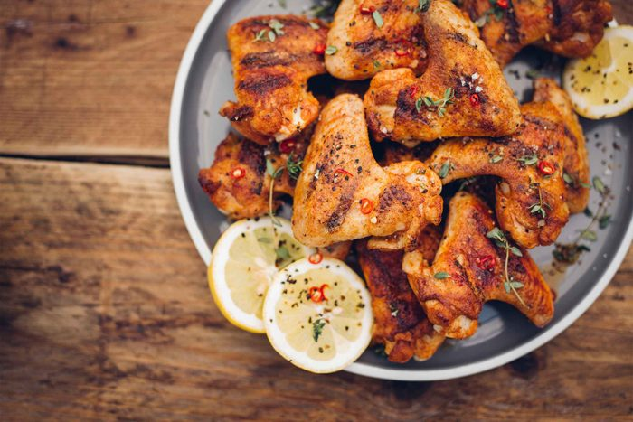 chicken wings piled high on a platter