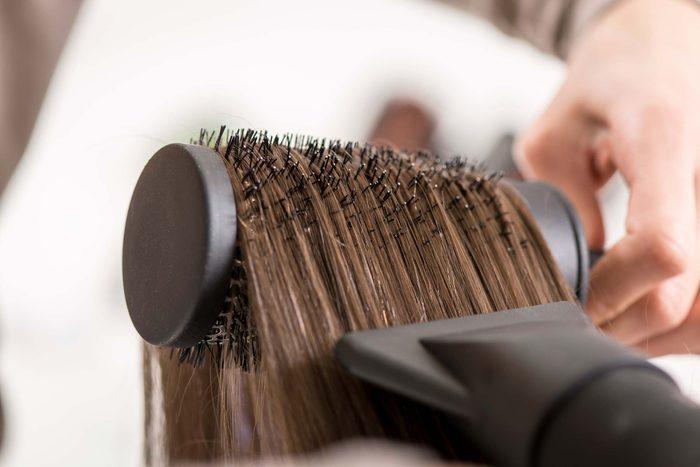 blowdrying hair in hair brush