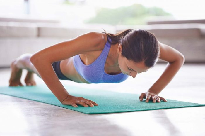 woman holding a plank pose