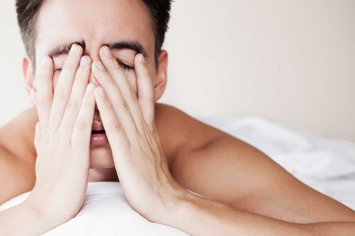 Tired man unable to sleep