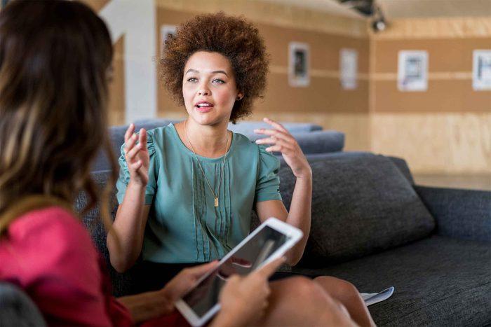 woman talking to friend