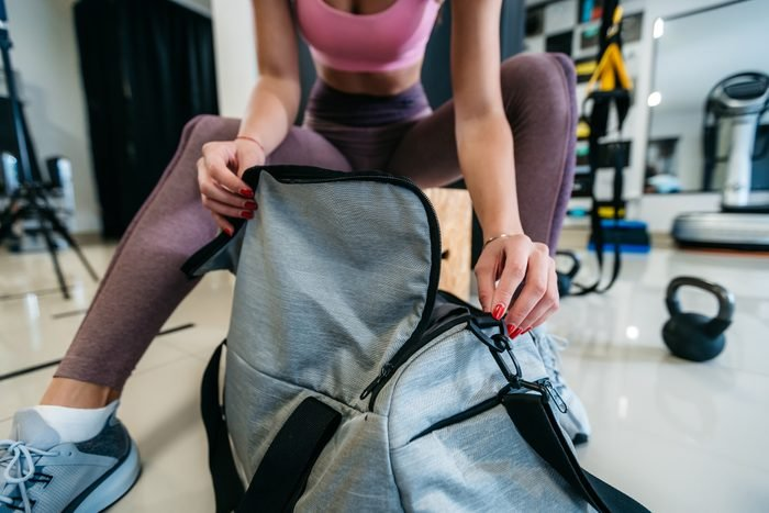 close up of woman opening gym bag