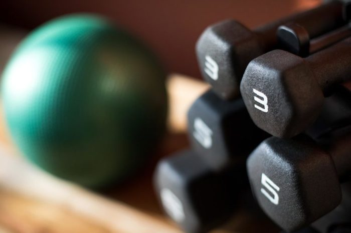 stack of weights next to medicine ball