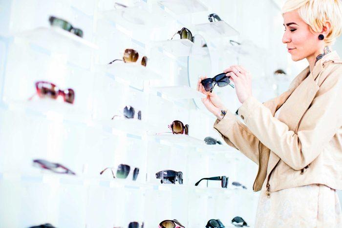 woman looking at sunglasses