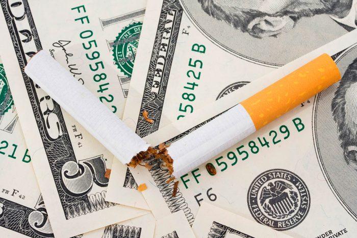 cigarette on money