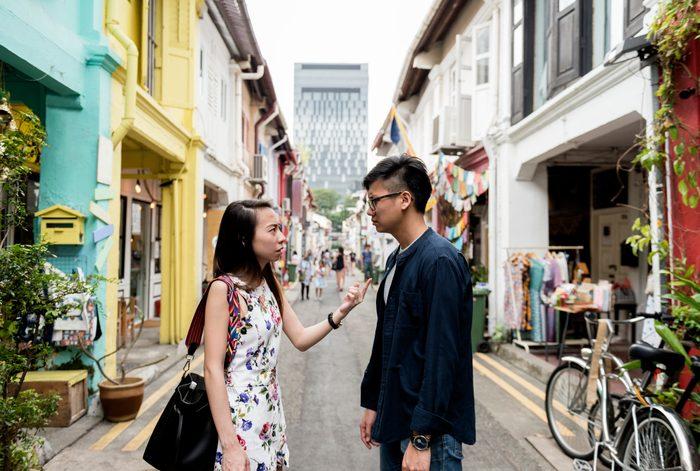 Couple arguing in public