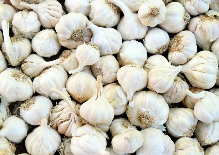 close up of group of whole garlic cloves
