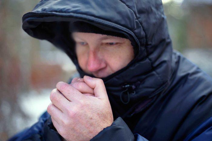 Man in winter coat looks cold