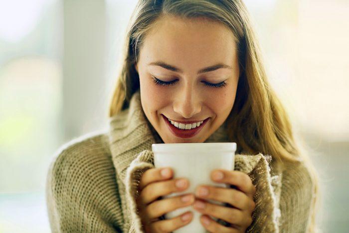 woman holding a large white mug