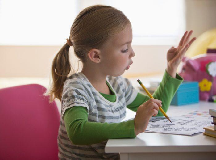 young girl doing math homework