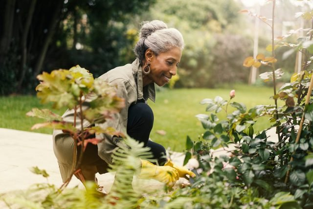 woman doing yard work and gardening at home
