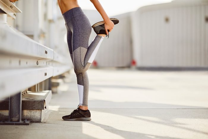 cropped shot of woman stretching before outdoor workout