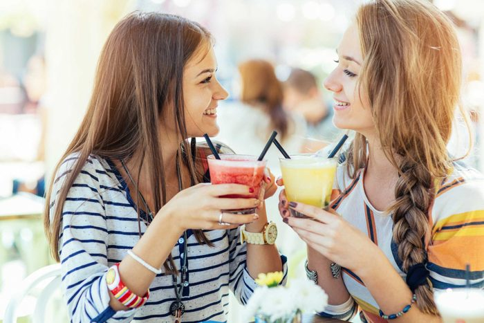 two women having smoothies