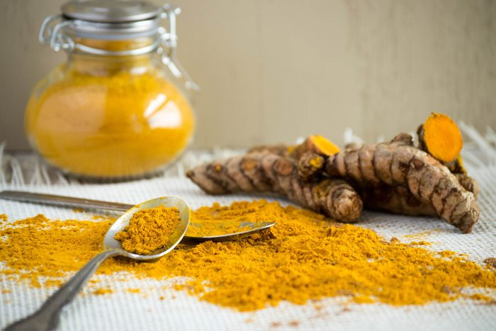 turmeric root, powder, and in a jar