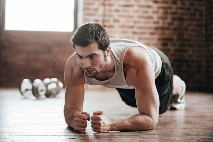 man in workout gear doing a plank
