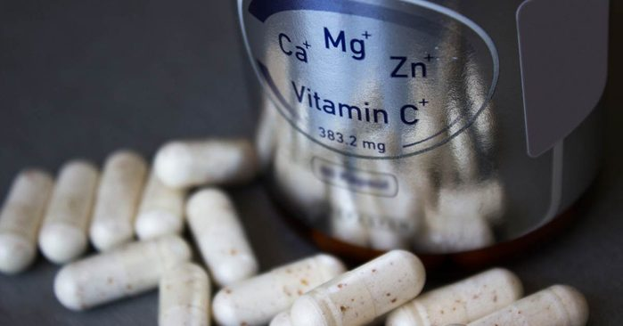 vitamin capsules on table