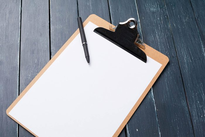 Blank piece of paper on a clipboard.