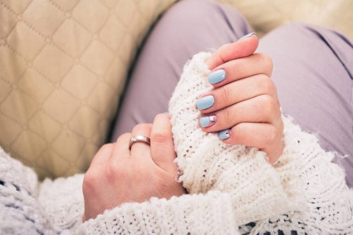 woman's hands with nails painted