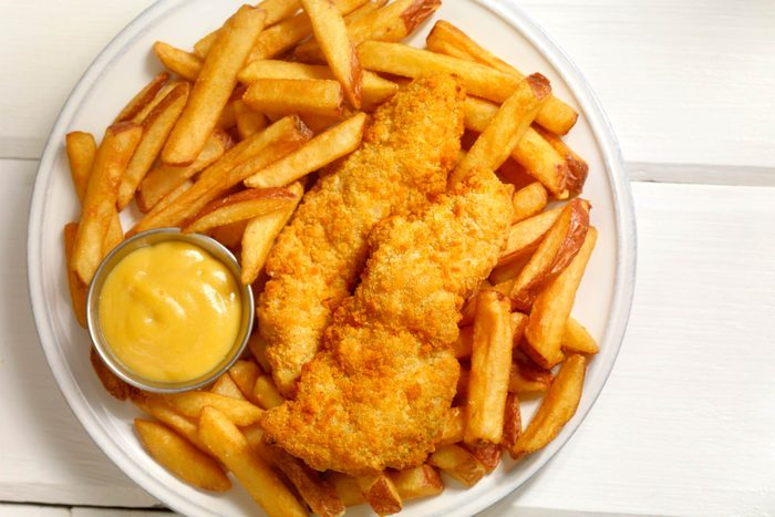 plate with fried chicken and french fries