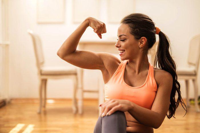 Woman flexing arm.