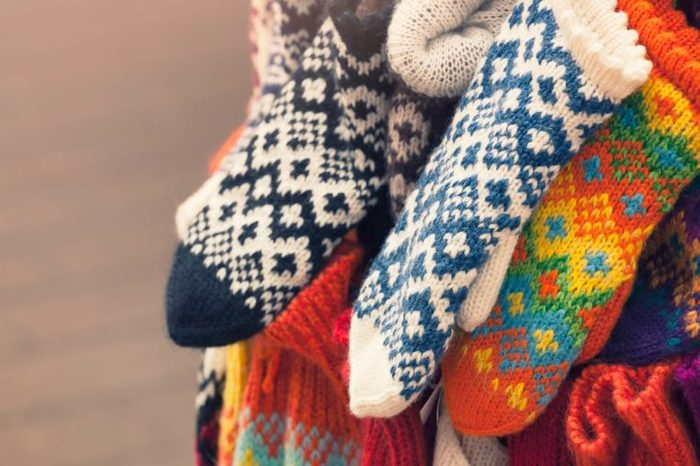 collection of knitted wool gloves