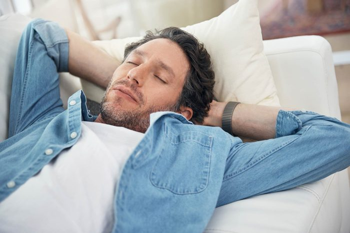 Man sleeping on couch.