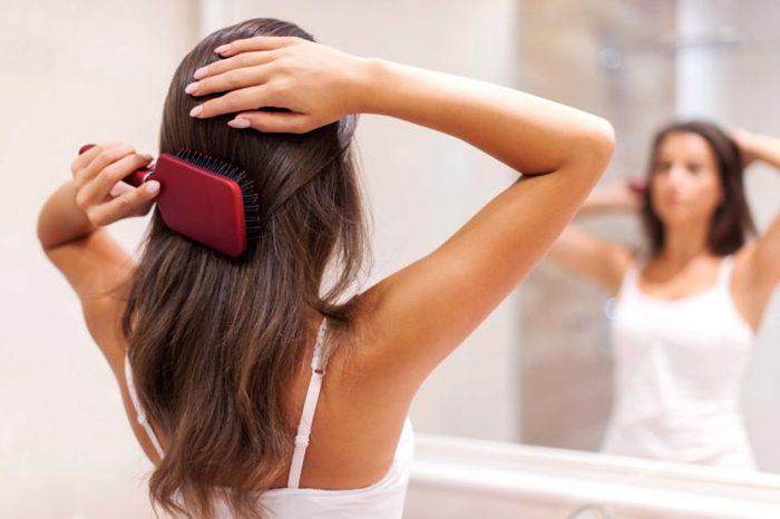 woman brushing her hair