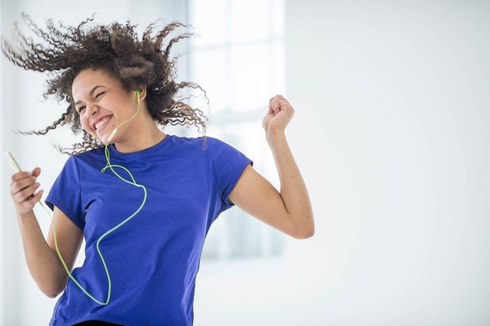 Woman with ipod dancing.