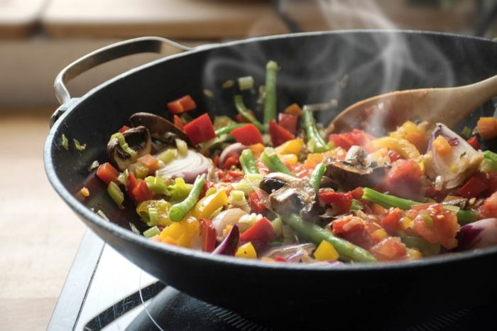 vegetable stir-fry cooking in a wok