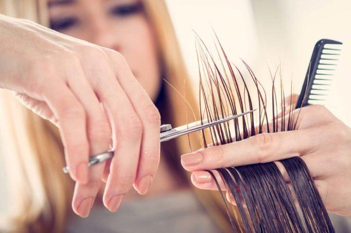 woman trimming hair