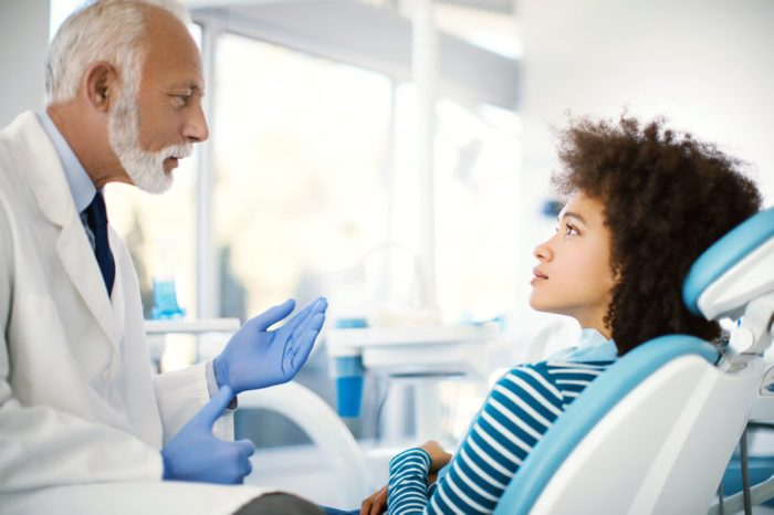 black woman dentist conversation procedure
