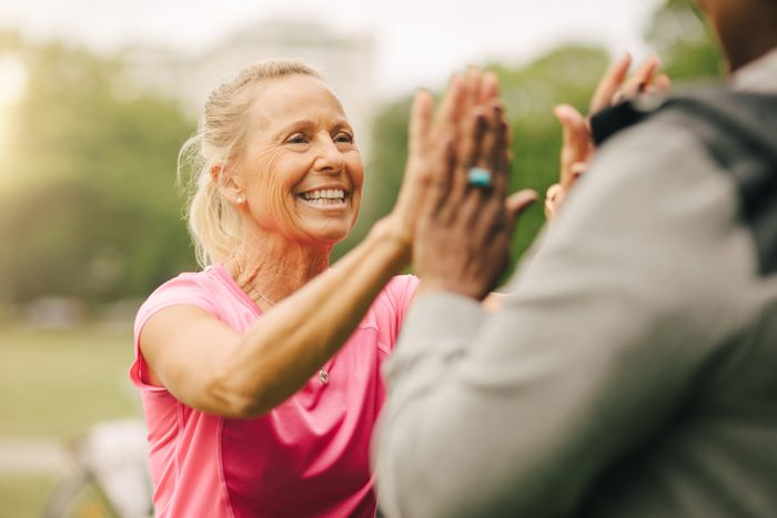 senior couple high five after exercise