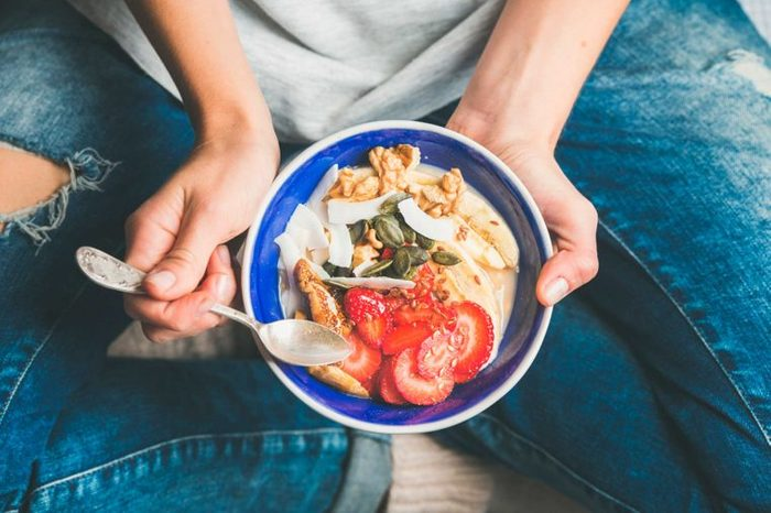 woman holding healthy salad in a bowl