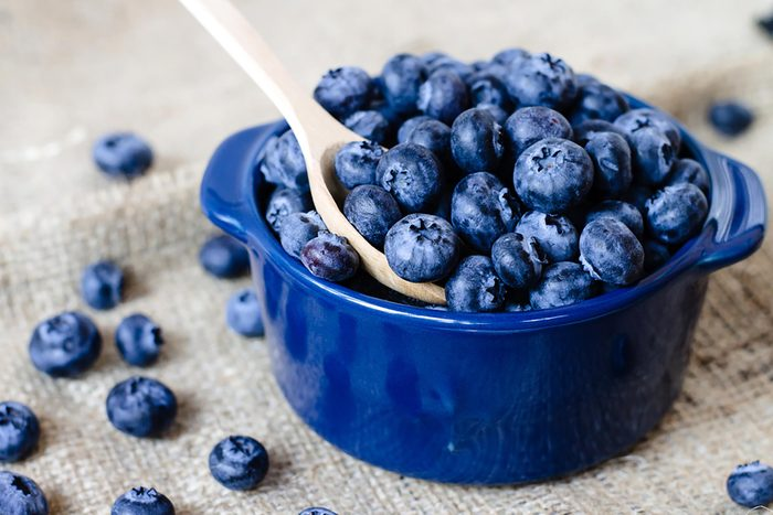 blueberries in a bowl with spoon