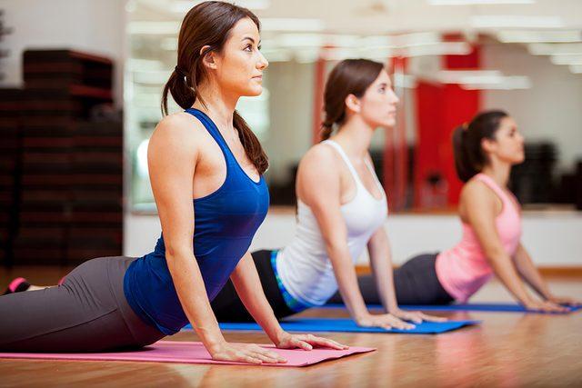 women upward dog, in yoga class