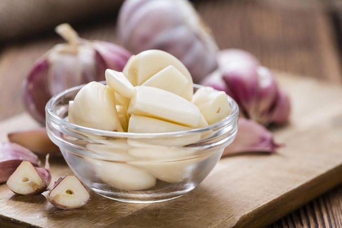 Bowl of pealed garlic cloves.
