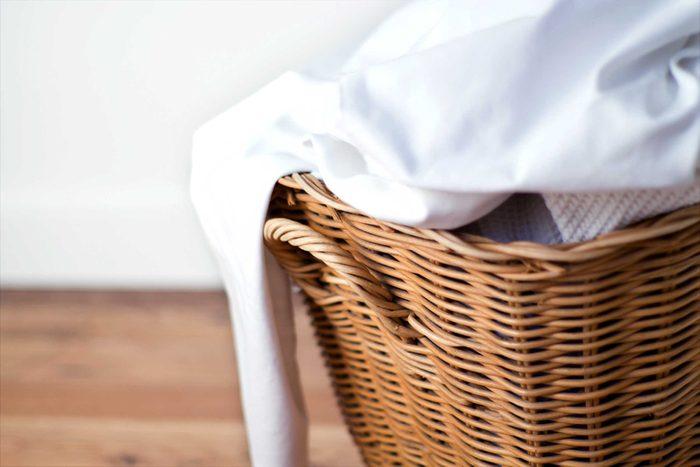 laundry in a wicker hamper