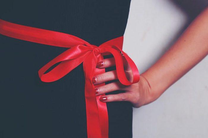 woman with ribbon around waist