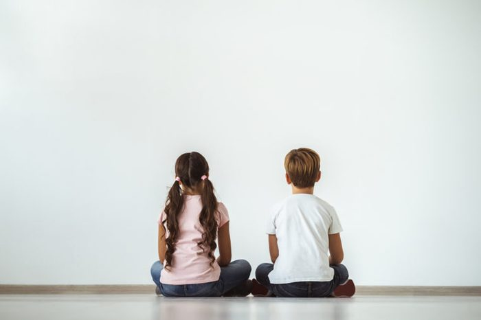 young girl and young boy sitting together