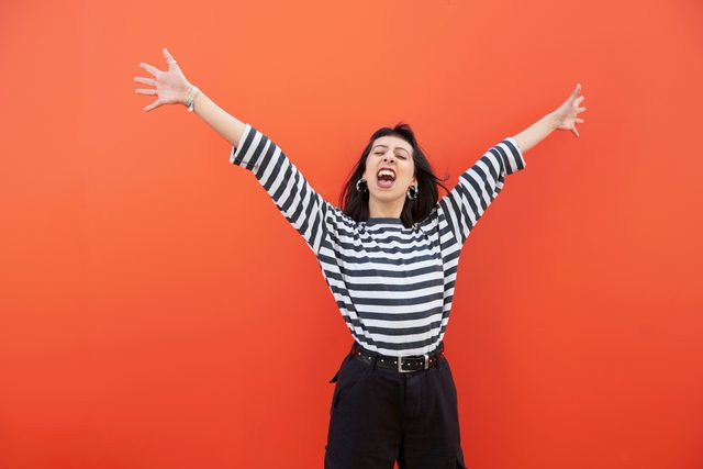 happy woman on red background