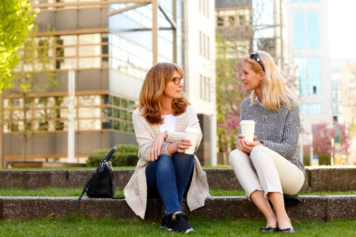 two moms talking