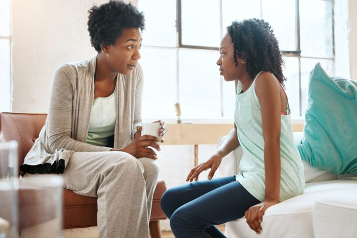 mother and daughter having conversation