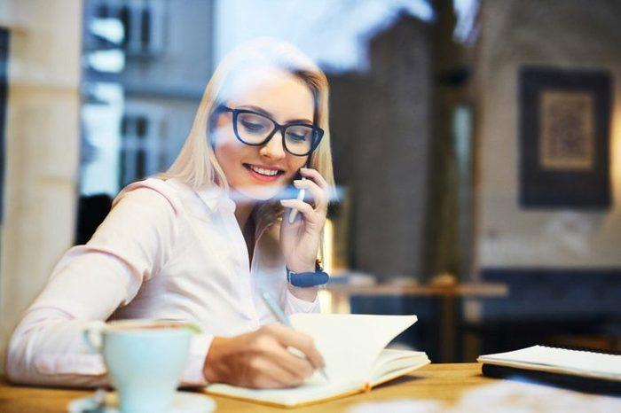 woman in coffee shop on phone