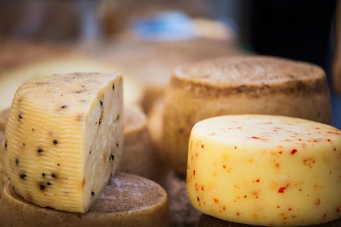 Wheels of aged cheese.