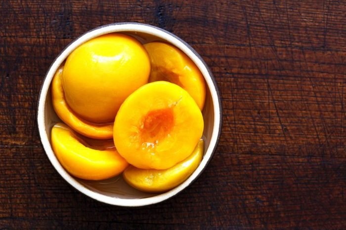 Bowl of peach halves taken from a can